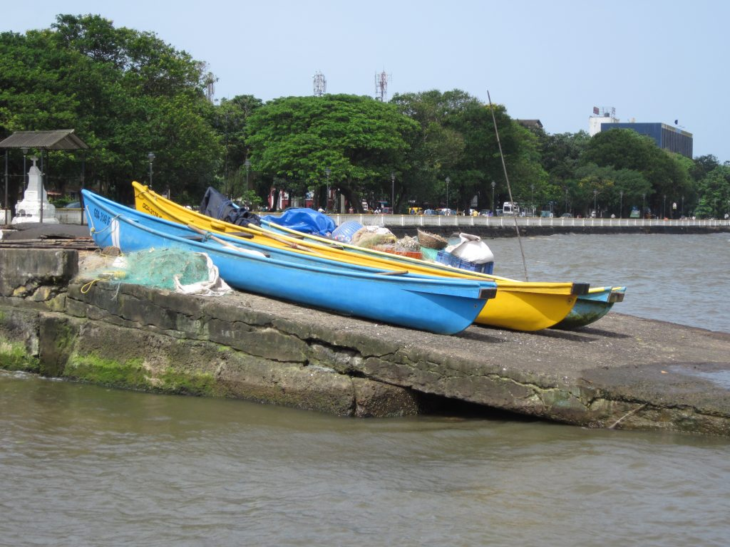 Canoe boats and nets (used by artisanal fishers on the Mandovi River) stationed at the Panaji ferry point. In the background is Dayanand Bandodkar Rd, which leads to (among other places) Miramar Beach.